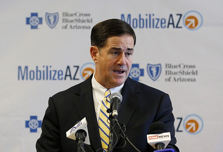 In this Aug. 14, 2018, file photo, Republican Arizona Gov. Doug Ducey speaks at a news conference in Phoenix. Proponents of Proposition 126 want to put a provision in the state constitution to forever preclude the Legislature from expanding the current sales tax base to services that are not already taxed. (Ross D. Franklin/AP, file)