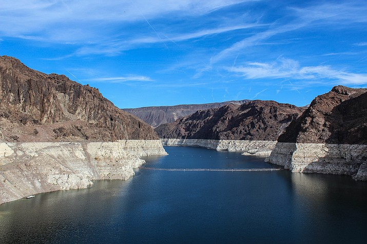 Water levels at Lake Mead are near historic lows. Lake Mead is now just 38 percent full. Under the current rules, if the reservoir's water level reaches 1,075 feet above sea level at the end of any year, the federal government will declare a shortage and supplies to Arizona and Nevada will be cut back. (Adobe Images)