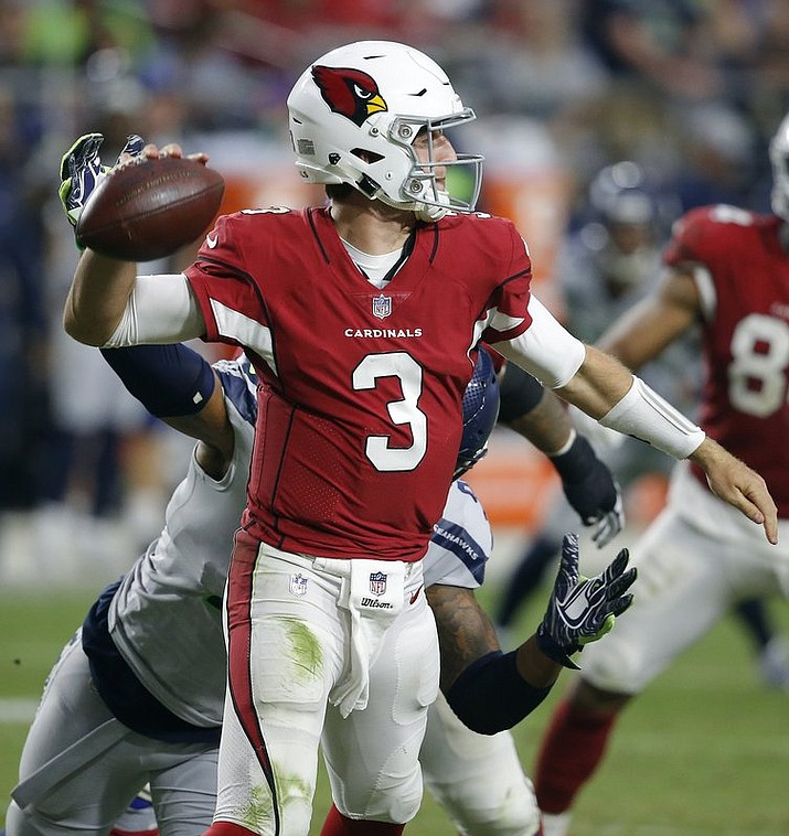 Arizona Cardinals quarterback Josh Rosen (3) throws against the Seattle Seahawks during the second half of the Cardinals 20-17 loss, Sunday, Sept. 30, 2018, in Glendale. (AP Photo/Ross D. Franklin)