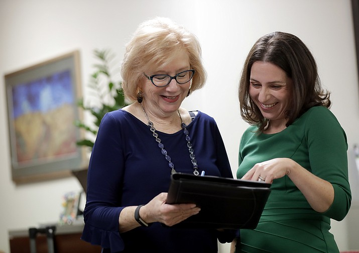Principal Scientist Jessica Langbaum, right, and her mother, Ivy Segal, 67, go over procedures for Segal's gene testing Tuesday, Aug. 14, 2018 at Banner Alzheimers Institute in Phoenix. (Matt York/AP)