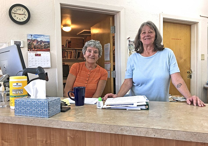 Andrea Dunn and Sherry Sleeper share the secrets of Williams Public Library.  (Wendy Howell/WGCn)