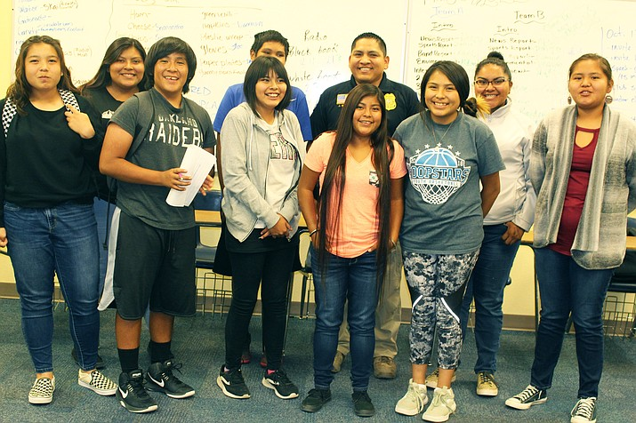 Hopi High AVID class surrounds K-9 officer Jared Shupla as he shares about his role in law enforcement and some of the challenges faced by the Hopi Tribe. (Stan Bindell/NHO)