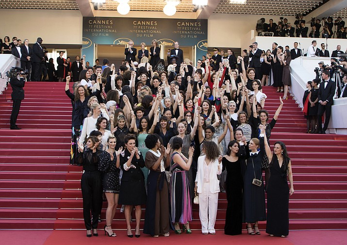 FILE - In this May 12, 2018 file photo, 82 film industry professionals stand on the steps of the Palais des Festivals to represent, what they describe as pervasive gender inequality in the film industry, at the Cannes Film Festival in Cannes, France. The #MeToo movement has gone far beyond the movies, but Hollywood remains ground zero in a cultural eruption that began 12 months ago with the revelations about Harvey Weinstein. (Photo by Vianney Le Caer/Invision/AP, File)