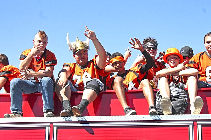 Vikings football players ride a float during the homecoming parade Sept. 27.