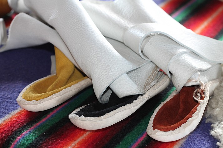 Traditional Navajo moccasins in gold, black and red. (Erin Ford/WGCN)