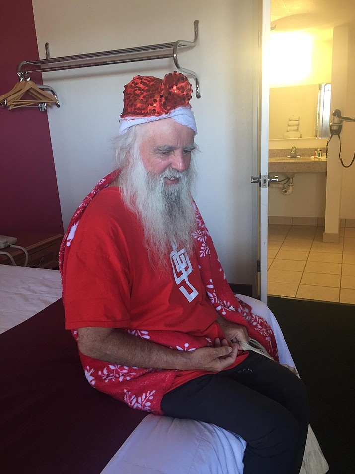 "James Zyla, Kingman's homeless ""Santa,"" checks out his room at Ramada Inn where he will stay in exchange for playing piano at Canyon 66 Restaurant and Lounge on Thursdays. (COURTESY PHOTO)"