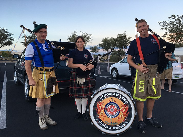 The Mohave Highlanders participated in the St. Judes fundraiser Wednesday evening at Chilis. Pictured from left are Mac Nelson and Erin Roper of the Kingman Fire Department and Justin Bacon of the Lake Havasu City Fire Department. (Vanessa Espinoza/Daily Miner)