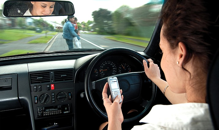 "The ordinance, which encompasses the unincorporated areas of Yavapai County, goes into effect 30 days after the board's approval. It states, ""A person shall not drive a motor vehicle while holding in his or her hand, typing on or otherwise manually operating a portable communications device."" Adobe stock image"