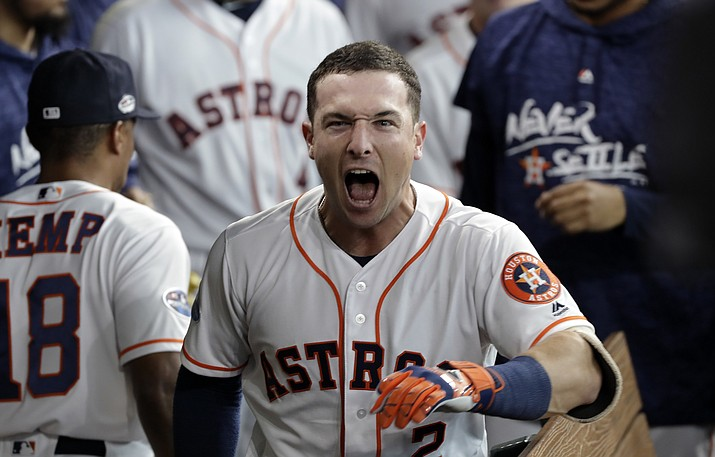 Houston Astros third baseman Alex Bregman (2) celebrates his solo home run during the fourth inning in Game 1 of an American League Division Series baseball game against the Cleveland Indians, Friday, Oct. 5, 2018, in Houston. (David J. Phillip/AP)