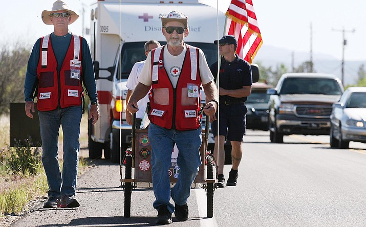 "Cottonwood resident Al Slusser walks through Beaver Creek in 2014 as he raised money for the Red Cross. On Oct. 8, Slusser will walk across the state to bring awareness to first responders. He calls the journey ""Walking for Heroes."" VVN/Bill Helm"