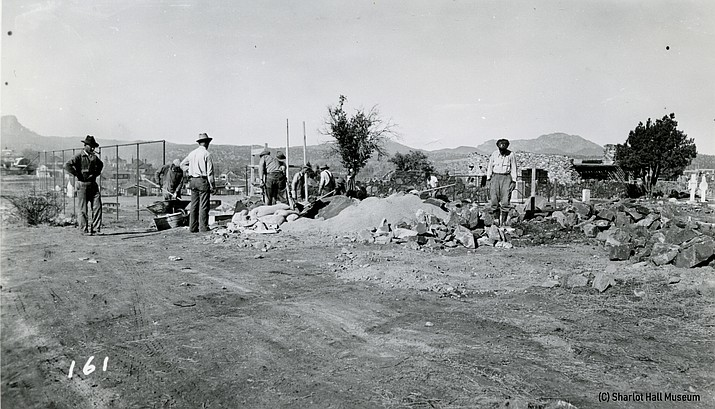 In 1934, a wall was constructed around Citizens Cemetery, Prescott's oldest burial ground, which was established in 1864.  This photo shows Works Progress Administration (WPA) laborers at work on the cemetery wall. Call number 1020.0101.0007.
