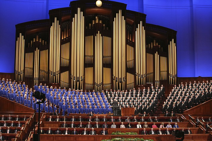 FILE - In this March 31, 2018, file photo, The Mormon Tabernacle Choir perform during the twice-annual conference of The Church of Jesus Christ of Latter-day Saints, in Salt Lake City. (AP Photo/Rick Bowmer, File)