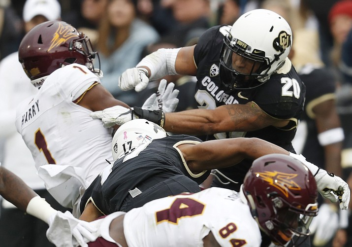 Colorado linebacker Drew Lewis, right, hits Arizona State punt returner N'Keal Harry in the second half of an NCAA college football game Saturday, Oct. 6, 2018, in Boulder, Colo. Colorado won 28-21. (David Zalubowski/AP)