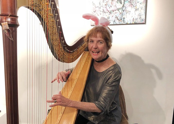 Anne Badger in Prescott plays her harp. (Courtesy)