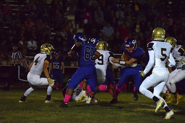 Camp Verde senior Steven Petty runs through a swarm of Bronc defenders during the Cowboys' 42-8 loss to Parker at home on Friday night. VVN/James Kelley
