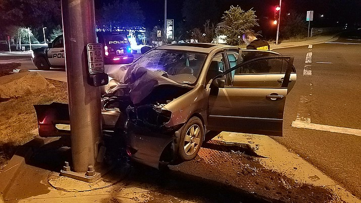 The driver of this vehicle was uninjured after striking a light signal pole at the intersection of Highway 69 and Walker Road at about 2 a.m. Saturday, Oct. 6, Prescott Fire Department reported. (Conrad Jackson, PFD/Courtesy)