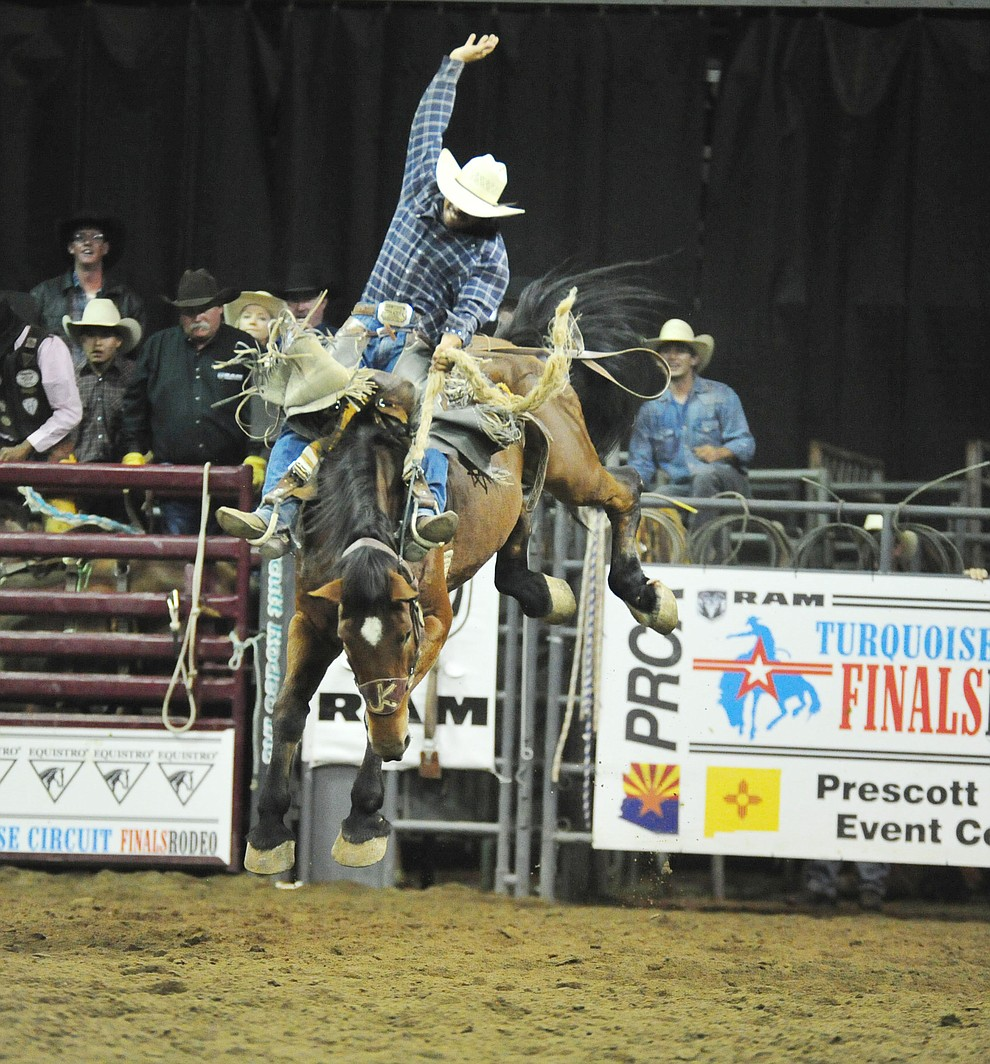 Leon Fountain rides Dakota Babe for a score of 83 and won the saddle bronc title at the Turquoise Circuit Finals Rodeo Saturday, Oct. 6, 2018 at the Prescott Valley Event Center. (Les Stukenberg/Courier)