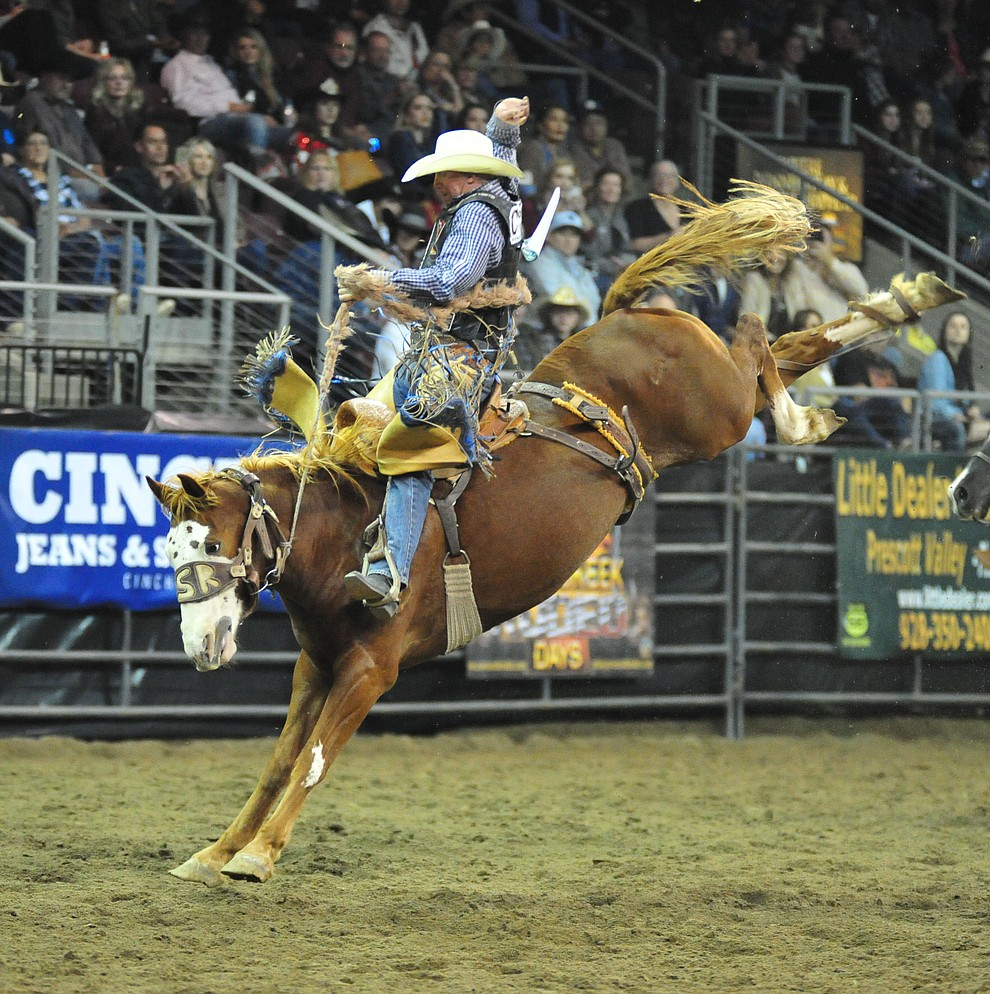 Taos Muncy on Buckshot scores 79.5 in the saddle bronc riding at the Turquoise Circuit Final Rodeo Saturday, Oct. 6, 2018 at the Prescott Valley Event Center. (Les Stukenberg/Courier)