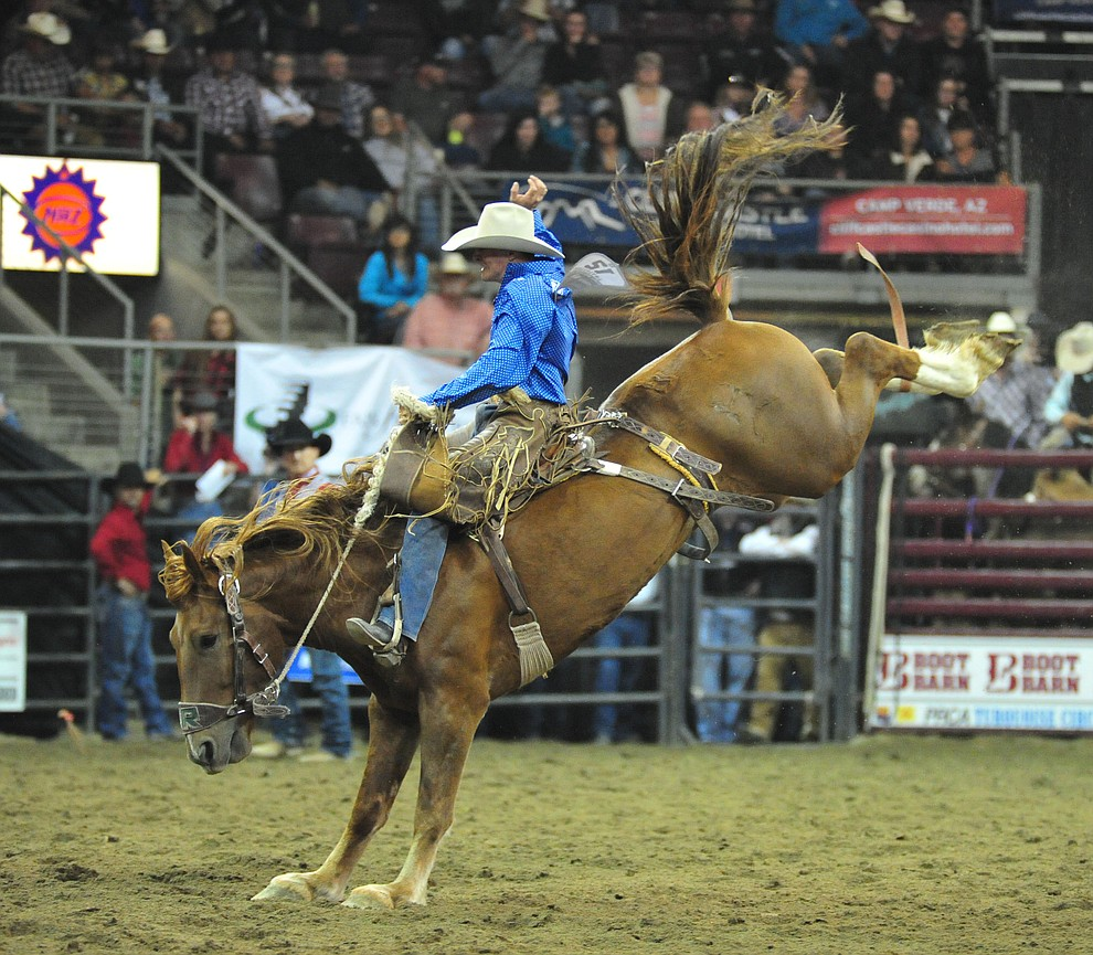 Ross Griffin scores 75 on Out of the Blue in the saddle bronc riding at the Turquoise Circuit Final Rodeo Saturday, Oct. 6, 2018 at the Prescott Valley Event Center. (Les Stukenberg/Courier)