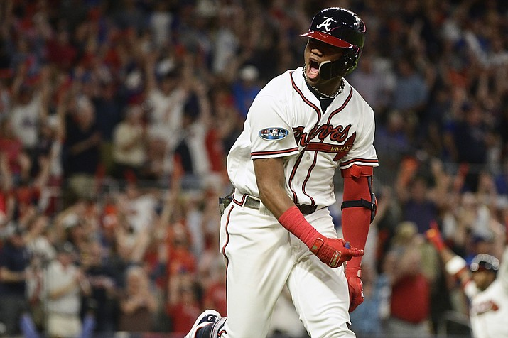 Atlanta Braves' Ronald Acuna Jr. (13) runs to first after hitting a grand-slam homer against Los Angeles Dodgers starting pitcher Walker Buehler during the second inning in Game 3 of MLB baseball's National League Division Series, Sunday, Oct. 7, 2018, in Atlanta. (John Amis/AP)