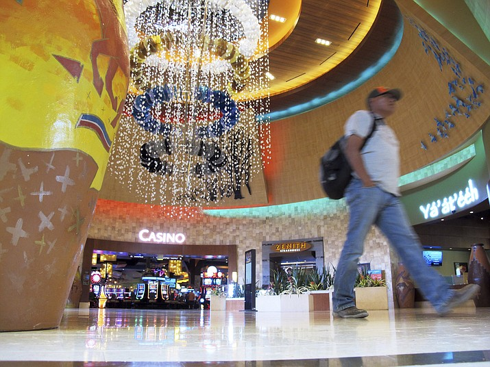 A man walks through the lobby of the Navajo Nation's Twin Arrows Casino, east of Flagstaff, Ariz., Tuesday, May 15, 2018. American Indian tribes are welcoming the opportunity to add sports betting to potentially hundreds of casinos across the country after the U.S. Supreme Court cleared the way for states to legalize it. (Felicia Fonseca/AP, file)