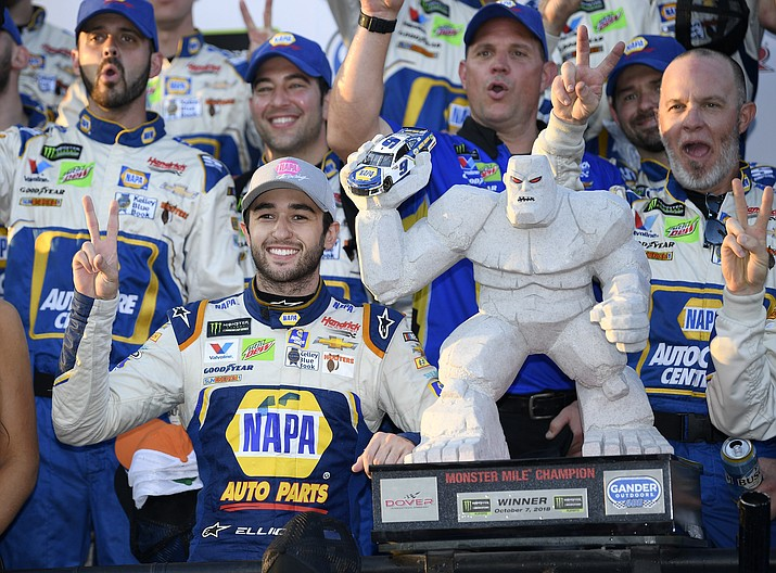 Chase Elliott, front left, poses with the trophy in Victory Lane after he won a NASCAR Cup Series auto race, Sunday, Oct. 7, 2018, at Dover International Speedway in Dover, Del. (Nick Wass/AP)