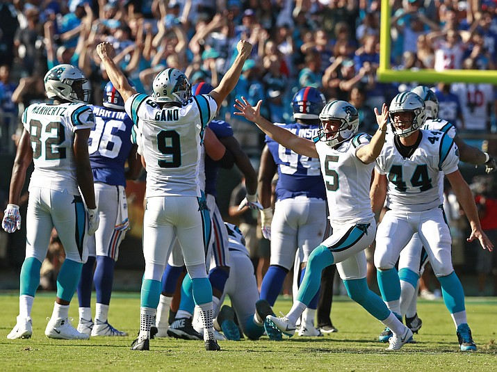 Carolina Panthers' Graham Gano (9) celebrates his game-winning field goal against the New York Giants with Michael Palardy (5) in the second half of an NFL football game in Charlotte, N.C., Sunday, Oct. 7, 2018. (Jason E. Miczek/AP)