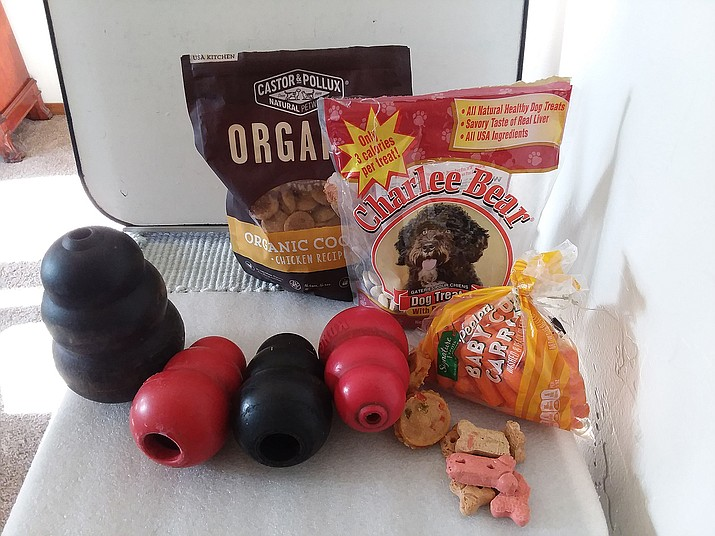 Kongs come in a variety of colors and sizes for small to large dogs. Any number of wonderful treats can be inserted for your pet's enjoyment and entertainment. (Christy Powers/Courtesy)