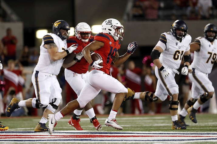Arizona safety Scottie Young Jr. (19) returns an interception during the second half of an NCAA college football game against California on Saturday, Oct. 6, 2018, in Tucson, Ariz. (Chris Coduto/AP)