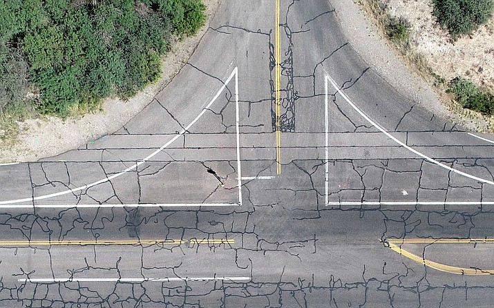 This aerial photograph of the intersection of Broadway and Palisades shows the severity of the deteriorating conditions of Clarkdale's street system. The town's Proposition 445, which will appear on the November ballot, allows for a carefully planned and executed maintenance program that will prioritize repairs on the worst of our roads to save them from complete failure. Photo courtesy of Doug Von Gausig.