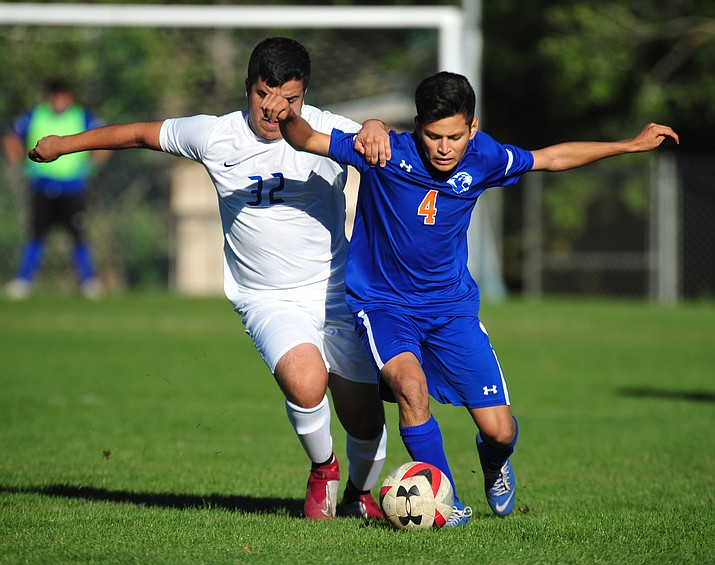 Chino Valley's Irving Vedolla battles for the ball as the Cougars host Camp Verde in boys soccer Tuesday, Oct. 9, 2018. (Les Stukenberg/Courier)