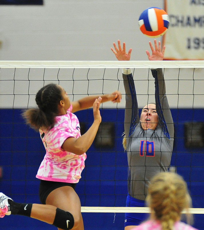 Chino Valley's Emma Brambila gets a block as the Cougars host Wickenburg in volleyball Tuesday, Oct. 9, 2018. (Les Stukenberg/Courier)