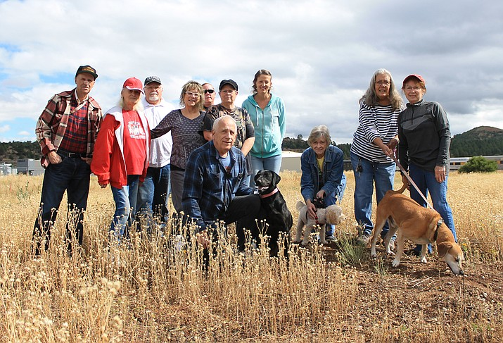 Members of SAVE Meant-To-Rescue gather at the location of the future animal shelter in Williams. The group continues to work toward raising the funds necessary to develop the land leased by the city of Williams. Pictured above: Ken Malpas, Cathy Hart, Harry Hart, Angela Price, Pat Anthony, Marie Cavaletto, Claire Grace, Diane Mansfield, Roy Mansfield and Sally Burcham. (Wendy Howell/WGCN)