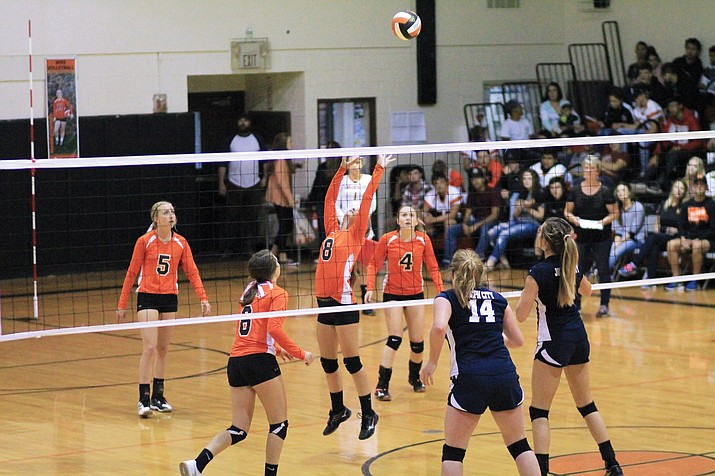 Madi Olson sets up the ball for a kill. (Wendy Howell/WGCN)