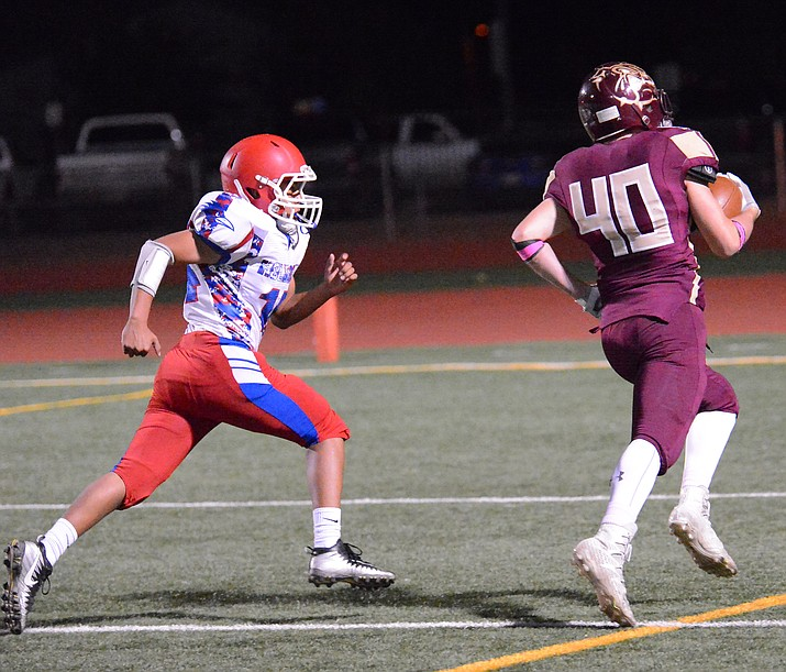 Mason Scott, (40) runs for a touchdown in the Bulldogs 50-0 win over Holbrook Oct. 5. (Todd Roth/NHO)