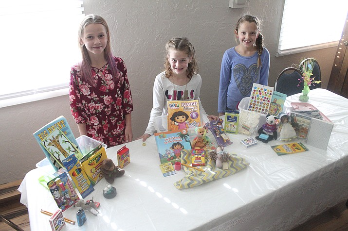 From left: Paige Kessler, Reese Trimble and Kallie Trimble show items that are packaged in Jared Boxes for children ongoing medical treatment. (Loretta Yerian/WGCN)