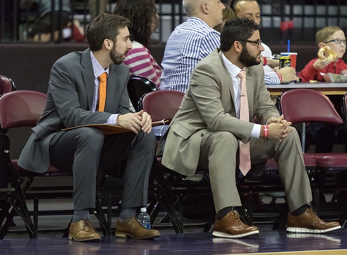 Assistant General Manager Dylan DeBusk, left, takes in a game last season alongside former Northern Arizona Suns General Manager Louis Lehman. DeBusk will act as GM moving forward until decisions are made at the NBA level under interim Phoenix GM James Jones. (NAZ Suns/Courtesy)