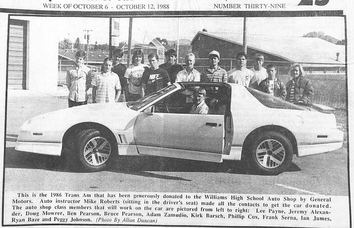 Auto shop students Lee Payne, Jeremy Alexander, Doug Mowrer, Ben Pearson, Bruce Pearson, Adam Zamudio, Kirk Barsch, Phillip Cox, Frank Serna, Ian James, Ryan Baze and Peggy Johnson post with the Trans Am. (WGCN photo)