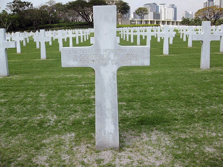 This 2011 photo provided by Ted Darcy, shows the unknown soldier grave site of Richard Murphy at the Manila American Cemetery at suburban Taguig city, east of Manila, Philippines.  (Ted Darcy via AP)