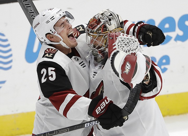 Arizona Coyotes' Nick Cousins (25) celebrates with goaltender Antti Raanta after the Coyotes defeated the Anaheim Ducks 3-2 in a shootout, during an NHL hockey game Wednesday, Oct. 10, 2018, in Anaheim, Calif. (Marcio Jose Sanchez/AP)