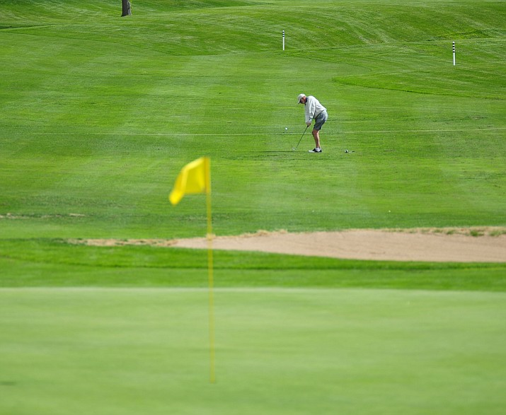 Golfers hit on the 18th hole at Antelope Hills Golf Course, Wednesday, Oct. 10, 2018, in Prescott. 