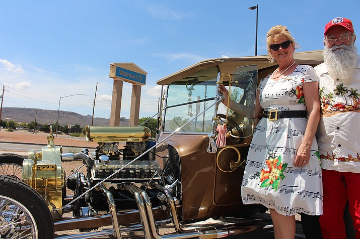 Steve and Mary Taylor of Dolan Springs, standing with their 1927 Ford T-Bucket, formed AZ Claus Cause to provide Christmas presents for underprivileged kids. They're holding a fundraiser car show Saturday at Mohave Community College. (Photo by Hubble Ray Smith/Daily Miner)