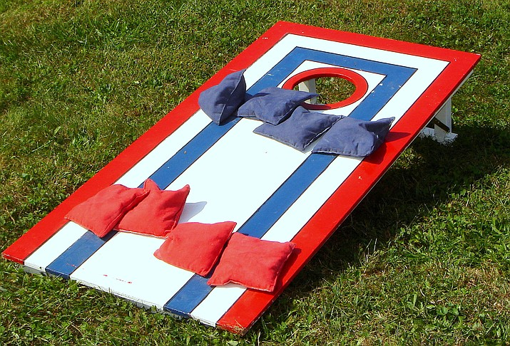 Cornhole is a lawn game in which players take turns throwing bags of corn or bean bags at a raised platform with a hole in the far end. (Adobe Images)