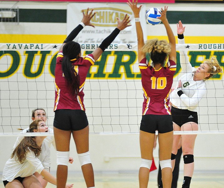 Yavapai's Annie Harte tries to get a kill between two blockers as the Roughriders take on Arizona Western Wed. Oct. 10, 2018 in Prescott. (Les Stukenberg/Courier)