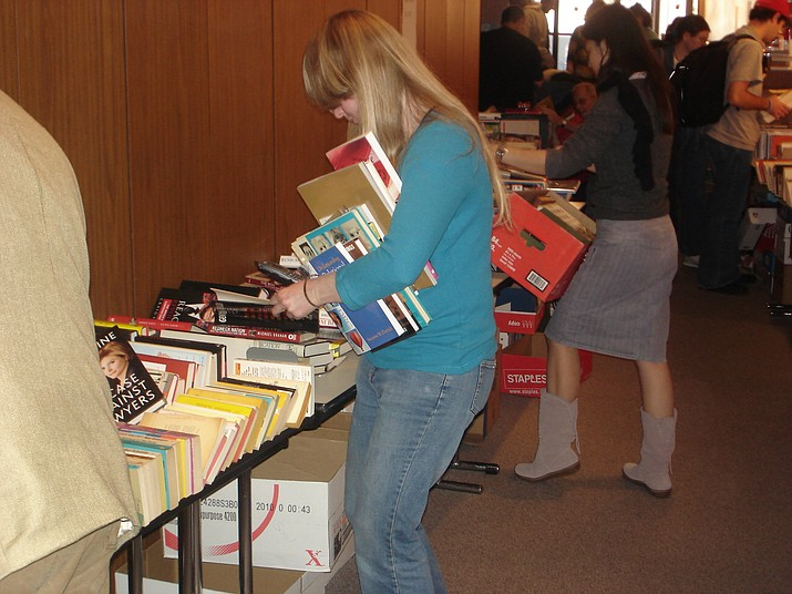 The Friends of Valle Vista Library is holding its Fall Book and Bake Sale from 9 a.m. – 2 p.m. Saturday at 7264 Concho Drive. (Photo by langsdalelibrary (Book Sale) [CC BY-SA 2.0  (https://creativecommons.org/licenses/by-sa/2.0)], via Wikimedia Commons)