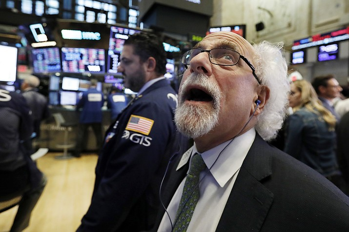Trader Peter Tuchman works on the floor of the New York Stock Exchange, Wednesday, Oct. 10, 2018. The Dow Jones Industrial Average plunged more than 800 points, its worst drop in eight months, led by sharp declines in technology stocks. (Richard Drew/AP)