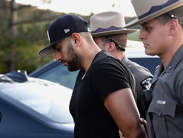 Nauman Hussain is brought into Cobleskill Town, N.Y., court for arraignment Wednesday, Oct. 10, 2018. Limousine service operator, Hussain, was charged Wednesday with criminally negligent homicide in a crash that killed 20 people, while police continued investigating what caused the wreck and whether anyone else will face charges. (Hans Pennink/AP)
