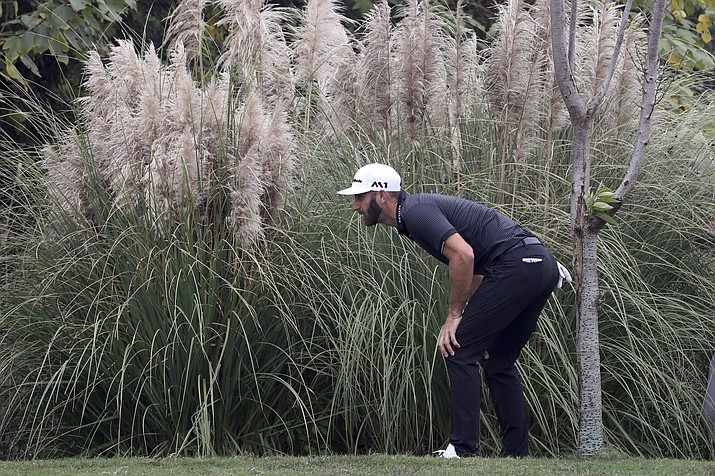Dustin Johnson of United States looks for his ball in the final round of the 2017 WGC-HSBC Champions golf tournament at the Sheshan International Golf Club in Shanghai, China, Sunday, Oct. 29, 2017 . (Ng Han Guan/AP file)