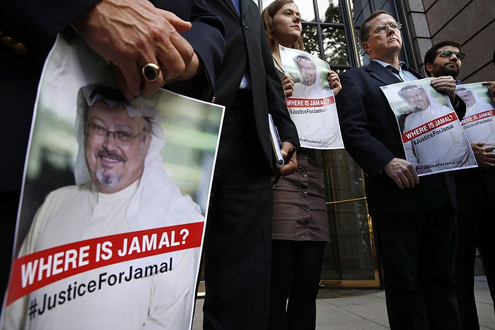 Alyssa Edling, center, and Thomas Malia, second from right, both with PEN America, join others as they hold signs of missing journalist Jamal Khashoggi, during a news conference about his disappearance in Saudi Arabia, Wednesday, Oct. 10, 2018, in front of The Washington Post in Washington. (Jacquelyn Martin/AP)