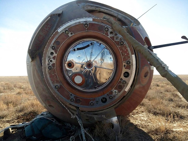 The Soyuz MS-10 space capsule lays in a field after an emergency landing near Dzhezkazgan, about 280 miles northeast of Baikonur, Kazakhstan, Thursday, Oct. 11, 2018. NASA astronaut Nick Hague and Roscosmos' Alexei Ovchinin lifted off as scheduled at 2:40 p.m. (0840 GMT; 4:40 a.m. EDT) Thursday from the Russian-leased Baikonur cosmodrome in Kazakhstan, but their Soyuz booster rocket failed about two minutes after the launch. (Russian Defense Ministry Press Service photo via AP)